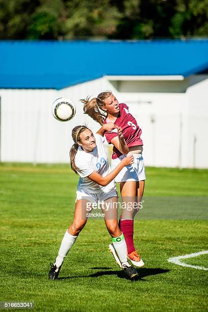 Two Female Soccer Players in Header Ball Redirect
