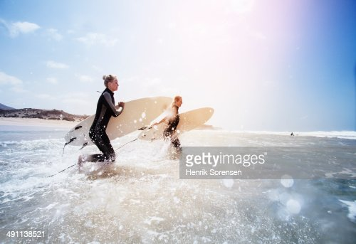 Two female surfers on the beach