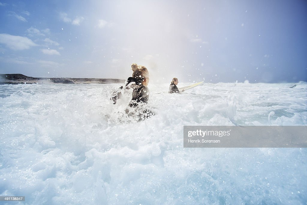 Two female surfers : Stock Photo