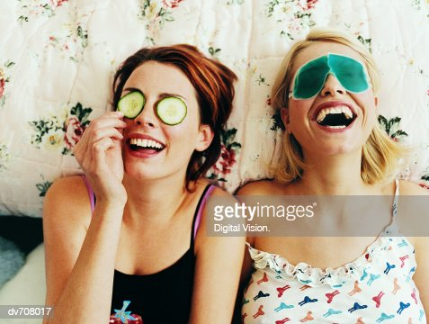 Two Female Teenagers Lying in Bed Wearing Eye Masks : Foto de stock