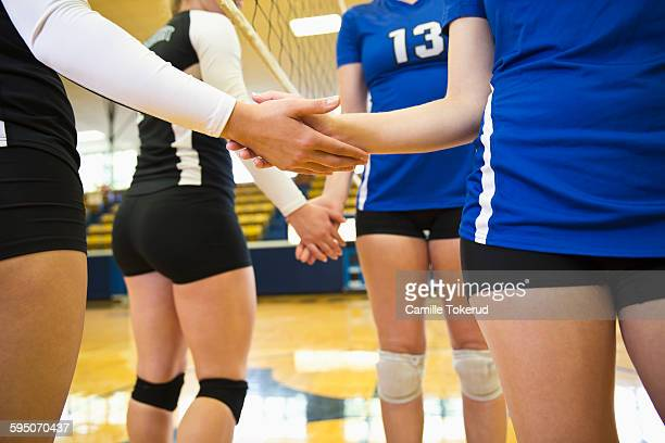 Two Female volleyball teams greeting eachother