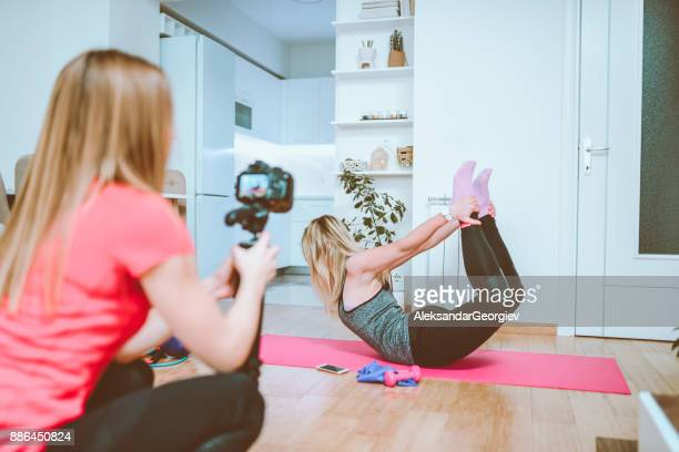 Two Females are Making Vlog About Stretching Before Exercising at Home