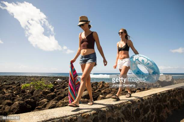 Two females heading to the beach.