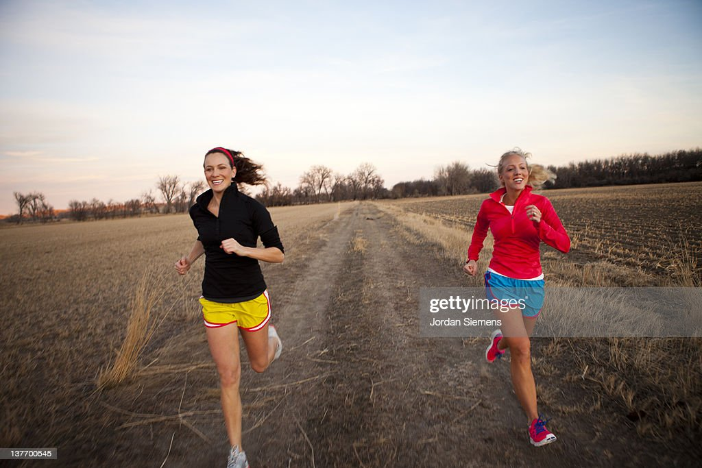 Two females running together. : Stock Photo