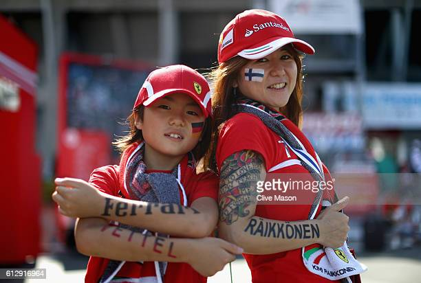 Two Ferrari fans in the fan zone at the circuit during previews ahead of the Formula One Grand Prix of Japan at Suzuka Circuit on October 6 2016 in...