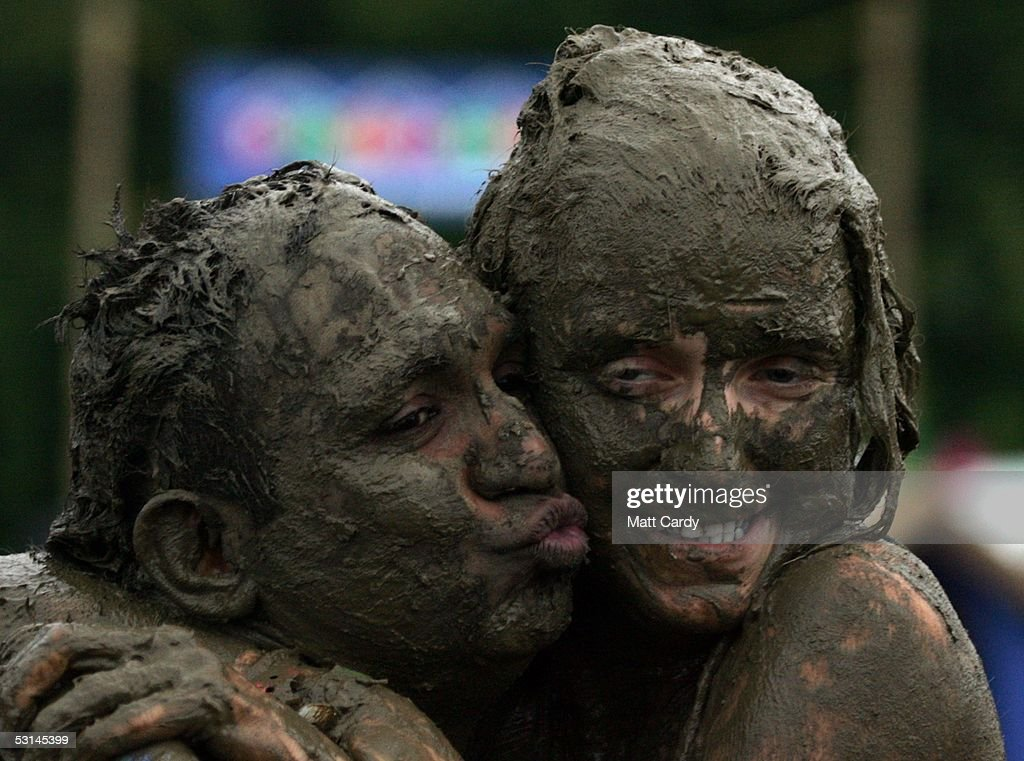 Two festival-goers enjoy the wet weather on the first day of the Glastonbury Music Festival 2005 at Worthy Farm, Pilton on June 24, 2005 in Somerset, England. The festival runs until June 26.