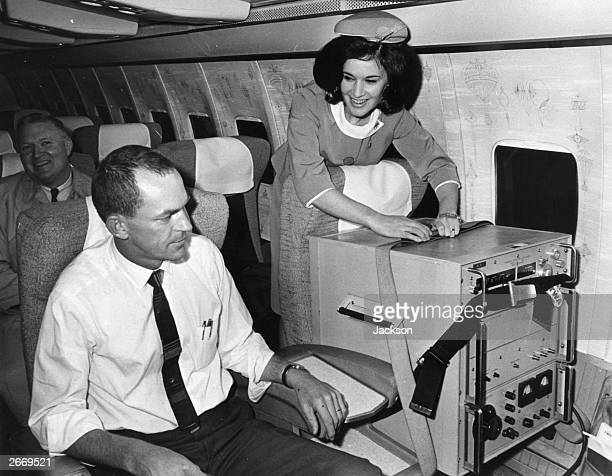 Two first class seats aboard a TWA jet from London to Washington One occupied by a caesium beam timepiece accurate to onemillioneth of a second used...
