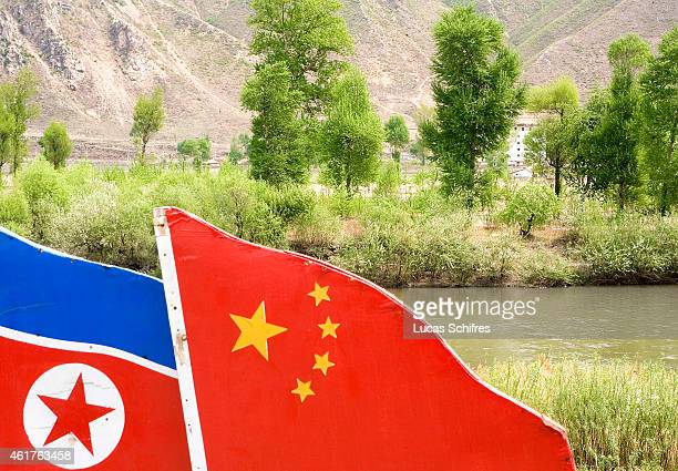 Two flags made of cardboard remind of the friendship between China and North Korea while North Korea is seen in the background at the ChineseNorth...