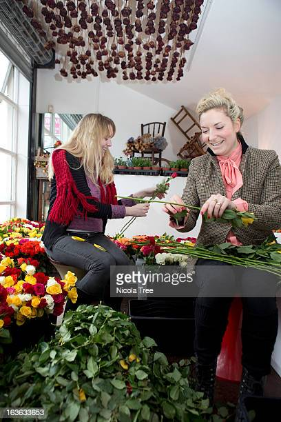Two florists working together in a shop