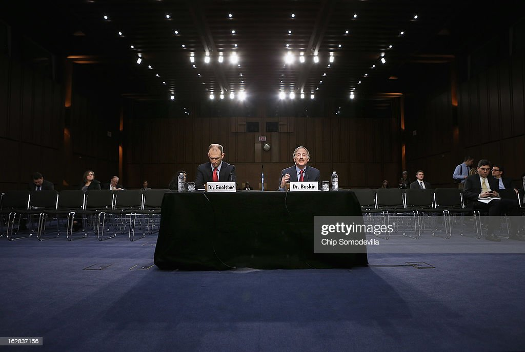 Two former chairmen of the Council of Economic Advisers, <a gi-track='captionPersonalityLinkClicked' href=/galleries/search?phrase=Austan+Goolsbee&family=editorial&specificpeople=4860114 ng-click='$event.stopPropagation()'>Austan Goolsbee</a> (L) and Michael Boskin testify before the Congressional Joint Ecoomic Committee on Capitol Hill February 28, 2013 in Washington, DC. Now economics professors, Boskin and Goolsbee disagreed on the speed of the nation's economic recovery during the hearing, titled 'State of the U.S. Economy.'