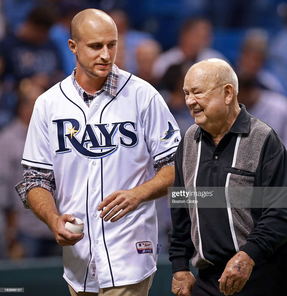 Two former members of the Red Sox and now both with Tampa Bay, Rocco Baldelli, left, and Don Zimmer took part in the pre game ceremonial first pitch. The Boston Red Sox visited the Tampa Bay Rays in Game Four of the ALDS baseball playoffs at Tropicana Field.