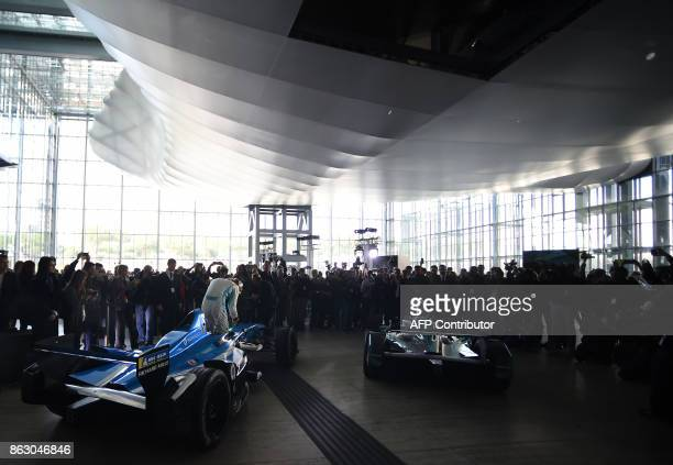 Two Formula E racing electric cars arrive at the 'Nuvola' Convention Centre prior a press conference in Rome on October 19 2017 Rome will host the...