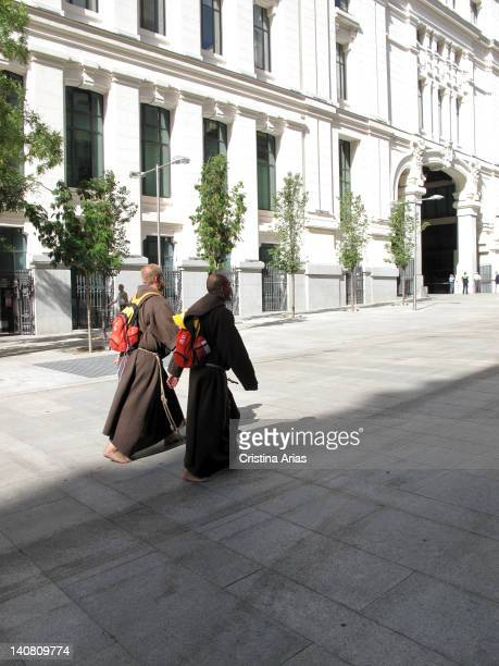 Two Franciscan monks walking barefooted along a street of Madrid during the celebration of the World Youth Day during the 16th to August 19 2011