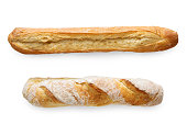 Two french crusty baguettes isolated at white background. Flat lay, top view