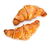 Two French croissants on white background