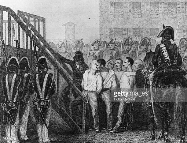 Two French revolutionaries with their hands tied behind their backs Bonas and Gaubin exchange a farewell kiss before being led to the guillotine...