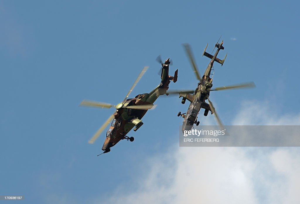 Two French Tigers helicopters flies over Le Bourget airport, near Paris on June 20, 2013 during the 50th International Paris Air show.