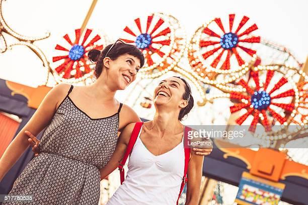 Two friends at amusement park