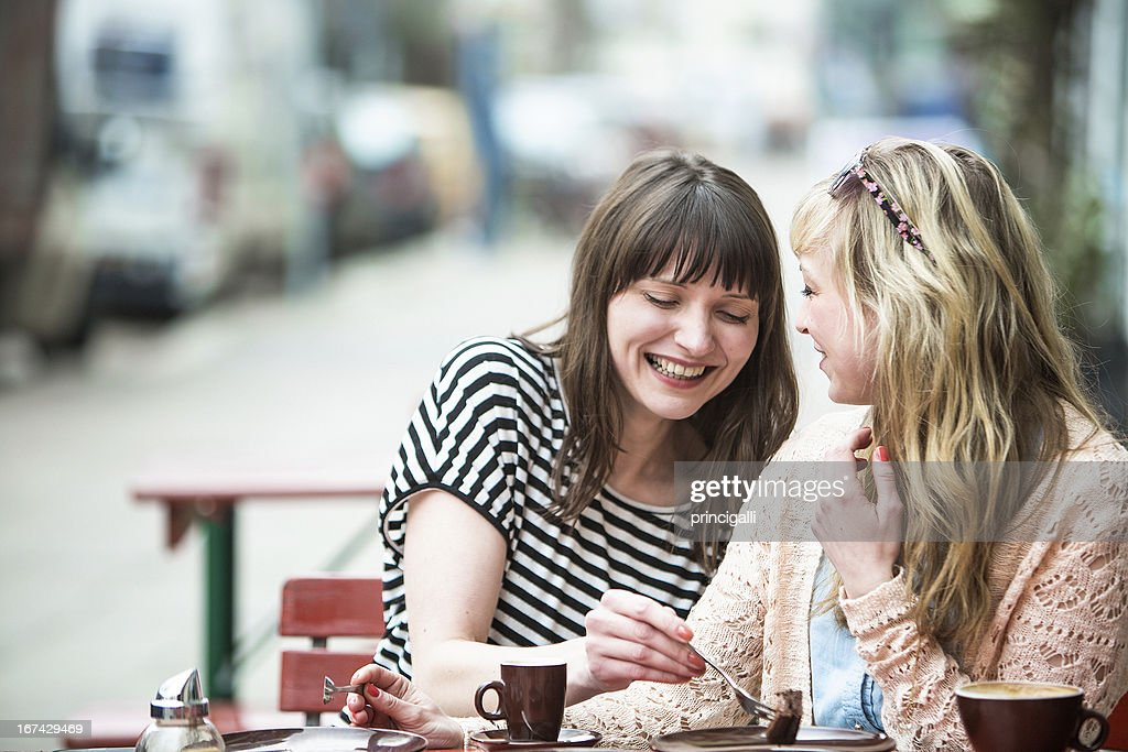 Two friends at the cafe : Stock Photo