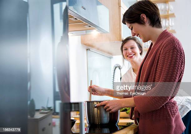 Two friends cooking a meal together