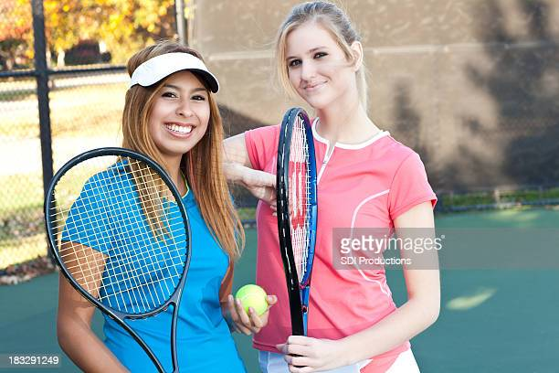 Two Friends Hanging Out Together at the Tennis Court
