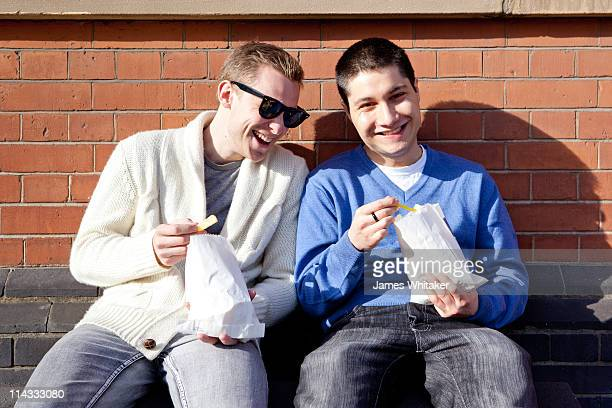 Two friends having fish and chips