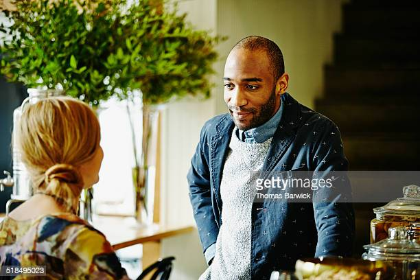Two friends in discussion in restaurant bar