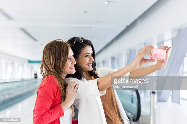 Two friends make selfie at Subway Station - Dubai