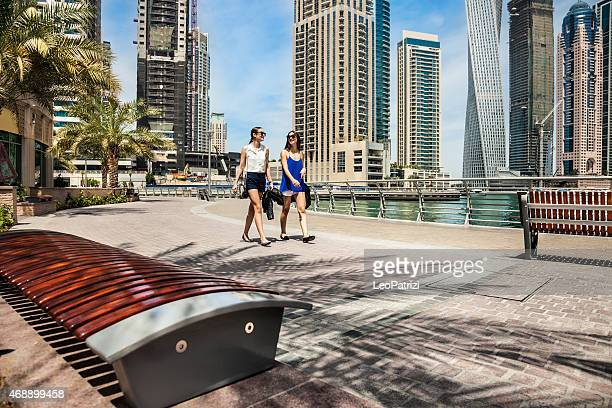 Two friends meeting in Dubai Marina downtown