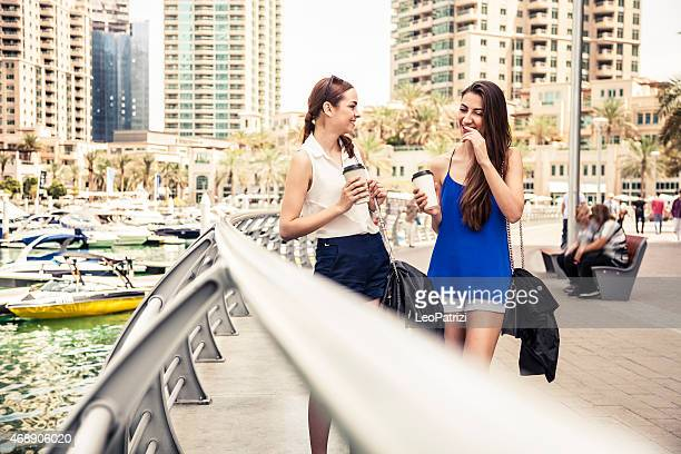Two friends meeting in Dubai Marina downtown