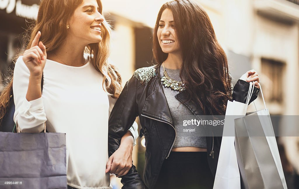 Two friends ont the street with shopping bags : Stock Photo