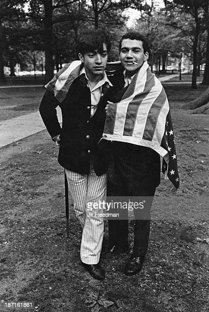 Two friends pose wrapped in the American flag in Newark New Jersey 1968