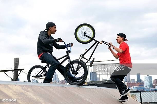 Two friends riding their BMX bikes near NYC