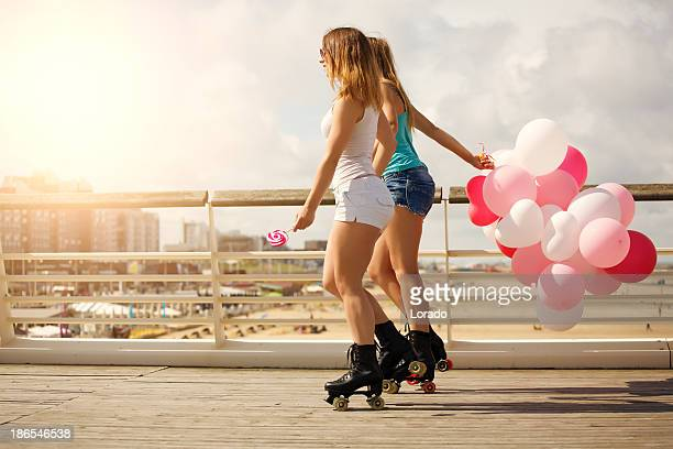 two friends roller skating outdoors