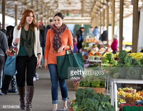 Two Friends Shopping at a Midwest Farmers Market.
