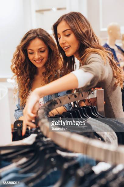 Two friends shopping for clothes