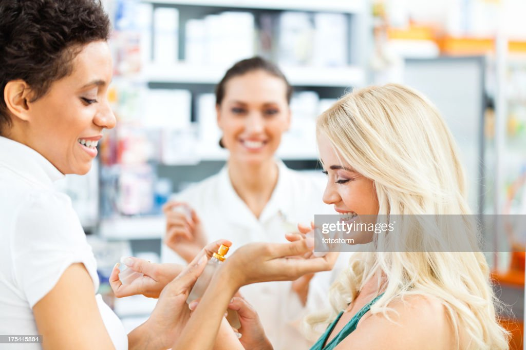 Two friends shopping for parfume