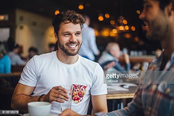 Two Friends Talking in a Cafe