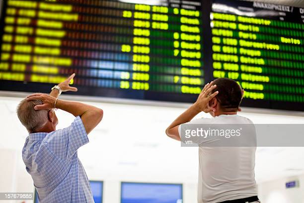 Two frustrated men looking at board