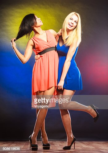 Two funny women in dresses. : Stock Photo