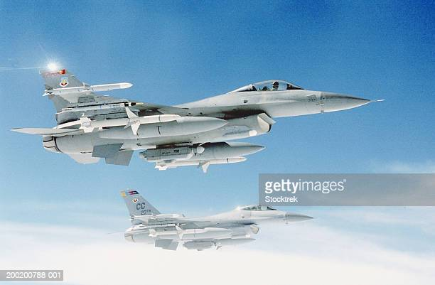 Two General Dynamics F-16 Falcons in flight