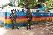 Two General Service Unit Officers stand guard outside the Malindi police station on March 28 2013 after six Mombasa Republican Council members were...