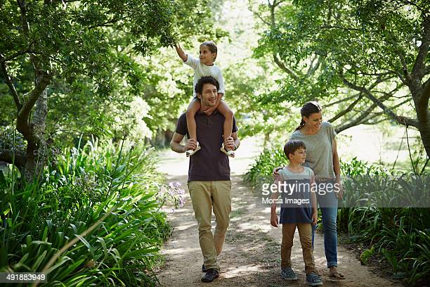 Two generation family walking in park