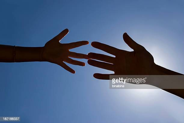 two generation hands touching