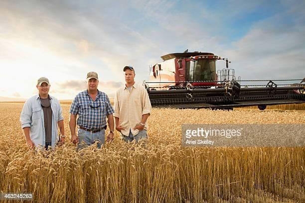 Two generations of Caucasian farmers in wheat field
