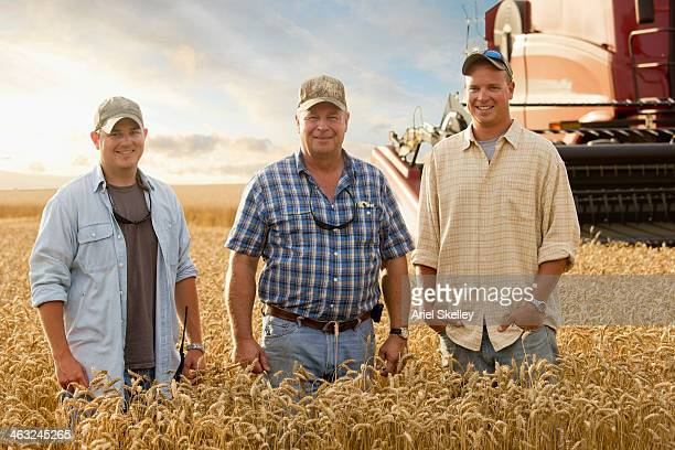Two generations of Caucasian farmers in wheat field