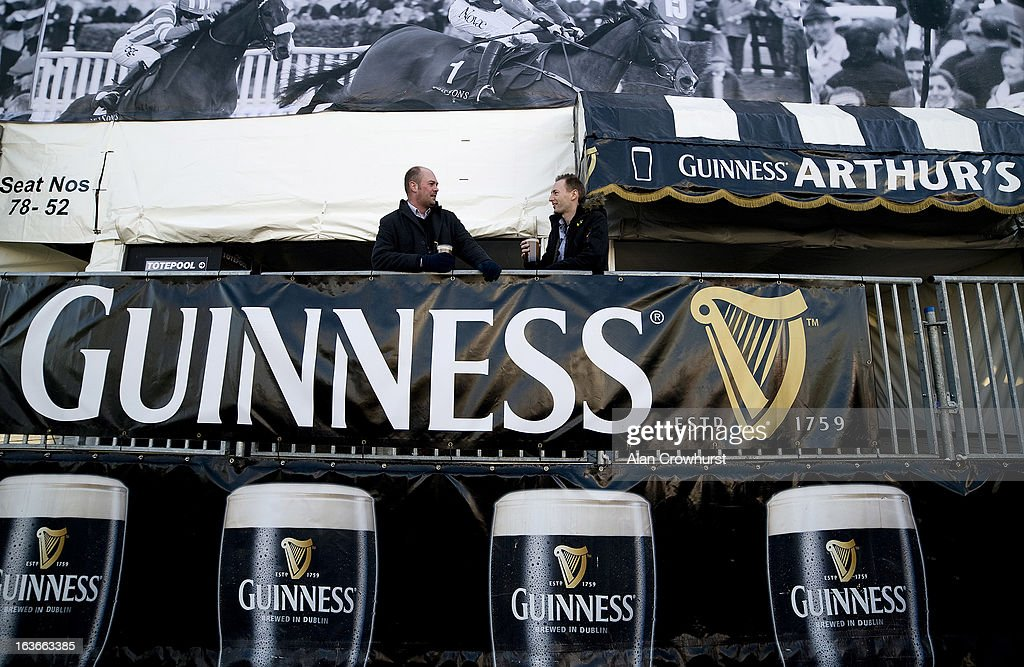 Two gentlemen enjoy an early drink before the crowds arrive during St Patrick's Thursday at Cheltenham racecourse on March 14 2013 in Cheltenham...