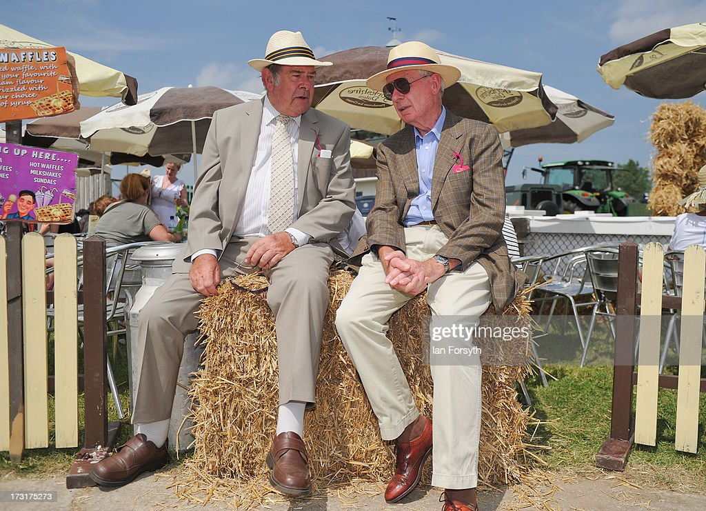 Two gentlemen take a break and chat as they sit on a couple of hay bales at the Great Yorkshire Show on July 9, 2013 in Harrogate, England. The Great Yorkshire Show is the UK's premier agricultural event and brings together agricultural displays, livestock events, farming demonstrations, food, dairy and produce stands as well as equestrian events to thousands of visitors over the three days.