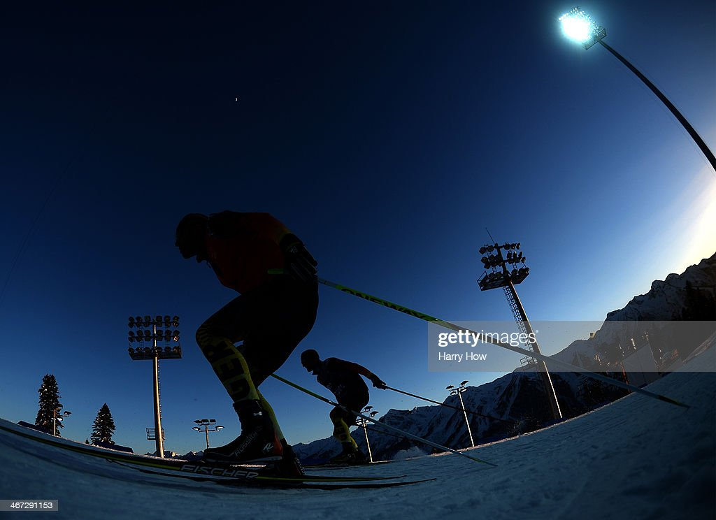 Two German athletes train ahead of the Sochi 2014 Winter Olympics at the Laura Cross-Country Ski and Biathlon Center on February 6, 2014 in Sochi, Russia.