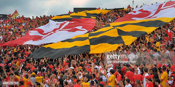 Two giant Maryland state flags covers the student section during the University of Maryland Terrapins defeat of the James Madison University Dukes in...